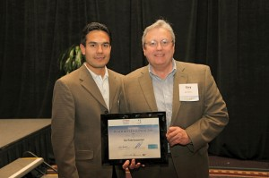 "Pedro of Aztec with Gary Peck, Gen-Probe's director of Human Resources, receiving the San Diego Business Journal's ""Healthiest Employer Award."""